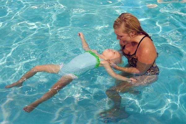 young girl back floating in a private swim lesson